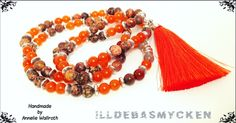 Malas necklace in orange, jandmade by me.