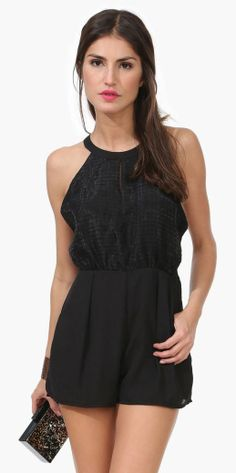 Embrace the summer romper trend with a  basic black ensemble, sleek locks, and a pink lip