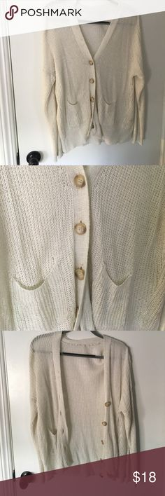 Brandy Melville Ivory Fisherman's Cardigan A light cardigan with brown buttons, perfect for summer. Size S but can also fit a M Brandy Melville Sweaters Cardigans