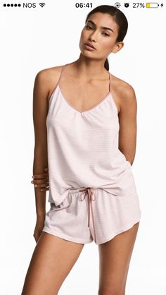 4bc47b215a Pyjamas with a cami top and shorts in soft jersey. Top with a gentle  V-neck, narrow shoulder straps and a racer back. Shorts with an elasticated  drawstring