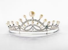 Chaumet. Curvilinear Tiara, created by Joseph Chaumet in the 1930s. White gold, diamonds and natural baroque pearls.
