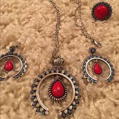 ♦️Ring, necklace, & earrings! 3 items! One price! A beautiful set of Rock 47 costume Jewelry in red, turquoise, rhinestones, and silver. Not stamped .925 and not authentic turquoise. Practically new. I think I have worn it together maybe one time. Ring is about 7-8 has opening at bottom as shown in pictures. Ring, necklace & earrings! Rock 47 Jewelry