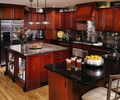 Cherry Wood Cabinets, Black Granite Countertops, Stainless Steel Appliances...Blue Walls