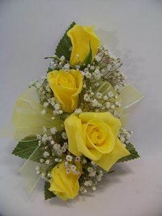 yellow rose corsage for mother of the bride/groom add a sunflower for the bigger flower instead of all roses.