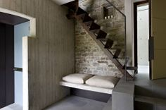 Architecture, Stone Wall Modern Rustic Mountain Hotel Design With Bench Seat And Cushions Under Iron Stairs: The Stunning Contemporary Boutique Hotel Torre Moravola