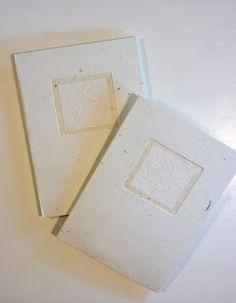 Handmade books covered with handmade paper.  kaksneljaseitteman.blogspot.fi