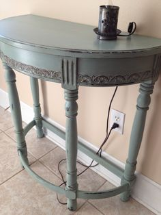 Antique foyer table with mirror. Was my grandmothers than passed to my dad and mom then to me. Duck Egg Blue Annie Sloan chalk paint with a small dollop of Old White then clear wax then a little dark wax on the detailed carvings. So happy with it!!