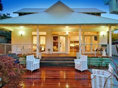 White Weatherboard house with corrugated tin roof