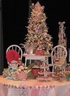 #Miniature #Christmas tree with lots of stuff. Chairs, #cupcakes, toys