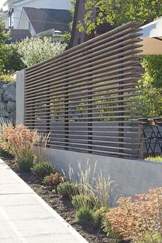 Horizontal Stacked Fence This ingeniously designed fence is sure to capture attention and awe. Using wood or metal slats, the stacked up installation is tough and contemporary. Effectively secures your space without blocking off the view.