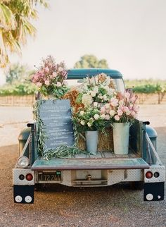 vintage wedding - flowers in the bed of an old truck