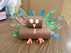 Thanksgiving Turkey made with toilet paper rolls.  For feathers-trace hands onto paper, flip paper over, and have children finger paint.  Cut out and staple to the back.