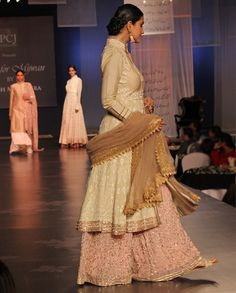 M. Malhotra. Beige chikankari kurta teamed with a pink georgette embroidered sharara along with a skin net dupatta.