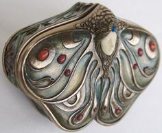 Art Nouveau snuff box?  Not a blue butterfly, but a pretty special butterfly all the same