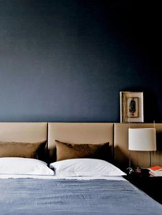 Possibly the ultimate color scheme for a masculine bedroom – crisp white linens, set off by shades of rich chocolate and slightly faded blues. Photo via ArkPad. l 'A SINGLE MAN': Some Masculine Bedrooms for The Fellas | D BLOG