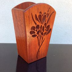 """Padauk wood and the vase is 7"""" tall"""