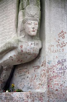 Grave of Oscar Wilde in Pere Lachaise Cemetery, Paris Defaced with lipstick kisses. The oil from the lipstick is degrading the stone. Love should come with respect.