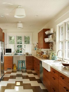 Open shelving provides necessary storage without the visual bulk of all-wood cabinets: http://www.bhg.com/kitchen/color-schemes/neutrals/beautiful-kitchens-with-natural-colors/?socsrc=bhgpin051814selfmadestyle&page=12