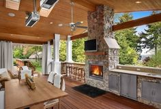 Craftsman Porch with Sunstone grills flush double access doors, Skylight, outdoor pizza oven, Outdoor kitchen, Transom window
