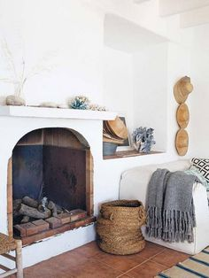 "42 Lovely Scandinavian Fireplace To Rock This Year. A stone fireplace design your pioneer ancestors would envy is the ""Multifunctional Fireplace."" The hearth is built up high to create a storage a."