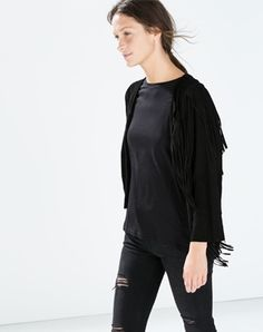 The iconic suede Western jacket looks downright urbane when it's stripped down to a boxy, short shape in basic black.