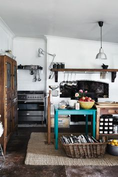 In a 160-year-old cottage in the Barossa valley, the original kitchen mantelpiece and concrete floor have been retained....