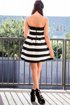 BLACK & WHITE STRIPE MINI DRESS   This adorable dress is a fabulous addition to any closet. Complete with a strapless cut and a flirty flare skirt, this dress will undoubtedly turn heads. This ultra feminine dress is designed with a stretch fabric to hug your body in all the right places.  #whiteandgold #tgif #happyfriday #fidofriday #mwc2015 #savwi #paintindia #kashmir #tenerife #tipsandtricks #wedding #bridal #bridesmaid #dress #stripes #offshoulder #fashionblogger #fashionblog