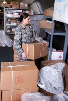 USAF Senior Airman Yolanda Rodriguez, 376th Expeditionary Mission Support Squadron, volunteers her time to sort mail on Manas Air Base, Kyrgyzstan, 18 Nov 2008