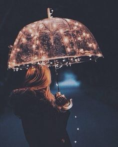 Rain. Umbrella. Lights.