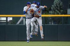 Dodgers outfielders Scott Van Slyke #33, Tony Gwynn #10 and Andre Eithier celebrate their 6-2 win vs. the  Rockies on   June 02, 2012.