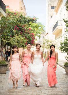 Bright bridesmaids dresses compliment Havana's energy perfectly!   Photography: Matt Kennedy - www.mattkennedy.ca  Read More: http://www.stylemepretty.com/destination-weddings/2014/06/25/old-world-charm-in-havana/