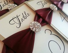 Elegant with gemstone accent   Gold & Burgandy table numbers for fall or winter weddings!