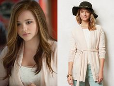 """Mia Hall (Chloe Grace Moretz) wears this white cardigan with a pointelle knitted trim and a belted tie up waist in the movie If I Stay. It is the Anthropologie Cosette Cardigan. Buy it<a href=""""http://bit.ly/1ttx6J4″> HERE</a>"""