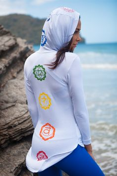 Our signature Chakra Hoodie features symbol representations of all 7 chakra points aligning itself perfectly along the body of the wearer . Made from visco-lycra the fabric is soft comfortable and lig