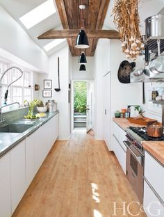 The airy and ample galley kitchen opens onto one of the property's many small garden areas.