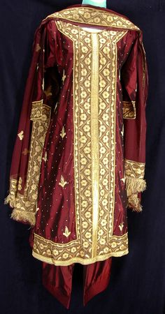 285007e9f5 Burgundy silk salwar kameez wih heavy mughal style embroidery complete with  fringe. Little India Salwar Boutique