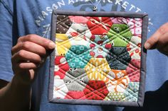 Hexie potholder.  I like the quilting, would never have thought to do it that way on hexies.