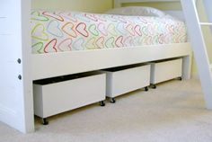 Under-the-bed roll out drawers. Add drawer pulls to make pulling them out easier.