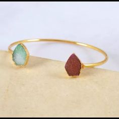 Druzy Gold Plate Cuff Bracelet Aqua Dark Pink Beautiful and trendy, this minimalist gold plated Druzy cuff style bangle will put the finishing touch on your outfit this summer with this classic piece and add a lariat bar style necklace to complete your lookPhoto of actual bracelet -New and still in packaging, thanks for stopping byFree gift with fashion jewelry purchase Jewelry Bracelets