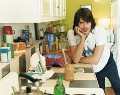 here is a creepy guy to tell you How to Organize A Small Apartment Kitchen (ok, honestly I just posted this because of the weird 70s seductive-looking guy)