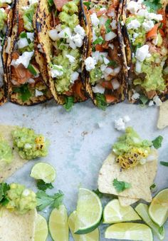 Chicken tinga tacos with grilled corn guacamole!