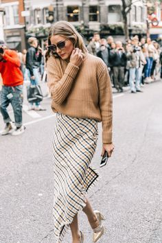 Great transition clothing - a sweater thrown over a summer skirt! London SS18 Street Style II