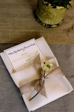 rustic details: dogwood sprig tied to each napkin with burlap ribbon