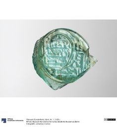 Glass stamp dating to the 8th century in Egypt.