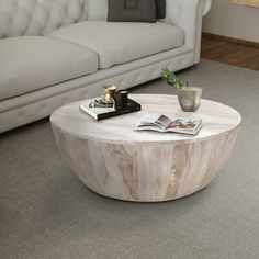 The Urban Port Mango Round Wood Coffee Table in light brown. Made from mango wood and features Features light brown finish and a wide tabletop. Mango Wood Coffee Table, Drum Coffee Table, Round Wood Coffee Table, Coffee Table Wayfair, Coffee Table Design, Coffee Cake, Tree Stump Coffee Table, Natural Wood Coffee Table, Unique Coffee Table