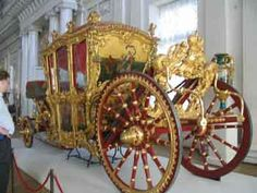 """July 20, 1991 I was lucky enough to go to Memphis to see  """"The Treasures of Imperial Russia"""" on loan from The State Hermitage Museum in Leningrad. Empress Catherine's coach was the most glittering of displays.  The coach is enormous and the brilliance and beauty of it far outshines this photo.  (Royal carriage of Catherine the Great)"""