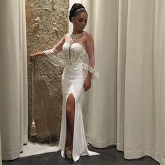 This stylish wedding gown has a very #sexy appearance.  The elegant sleeves combines with the beaded embellishments make a lovely #fashion statement.  When you are having custom #weddingdresses made specifically for you we can produce a design with any change you want.  Get pricing on beautiful wedding gowns like this when you email us directly from our main website.