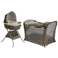 Hm, we already have a pack-n-play but I like this bassinet. (Why are all the others so ruffly and goofy?!) Graco Day2Night Sleep System - Antiquity | BabiesRUs