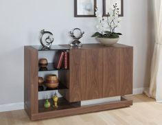 JUAL Cube Walnut Sideboard JF613 This stylish Italian designed sideboard has handle-less doors and large internal storage along with useful shelving. Canadian Walnut veneers, modern piano black glass and brushed stainless steel are u http://www.MightGet.com/january-2017-13/jual-cube-walnut-sideboard-jf613.asp