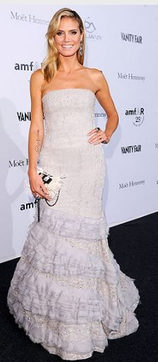 Who made Heidi Klum's strapless gown that she wore in Milan on September 23, 2011? Dress – Roberto Cavalli